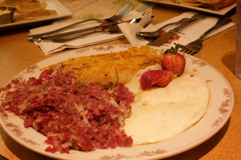 <center>Corned Beef Hash with eggs and potatoes</center>