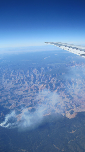 Flying home, a view of the Grand Canyon with a fire.