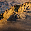 Natures' creativity...<br /> <br /> East Beach<br /> Santa Barbara, CA<br /> <br /> This bit of erosion was maybe 2' deep and probably 15-20' long. The early morning sun was creating beautiful golden light and neat shadows that caught my eye. I couldn't resist taking a shot. Best in larger sizes...<br /> <br /> Your comments are much appreciated, thank you!<br /> <br /> Critiques welcome...<br /> <br /> March 29, 2013
