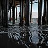 under the pier...