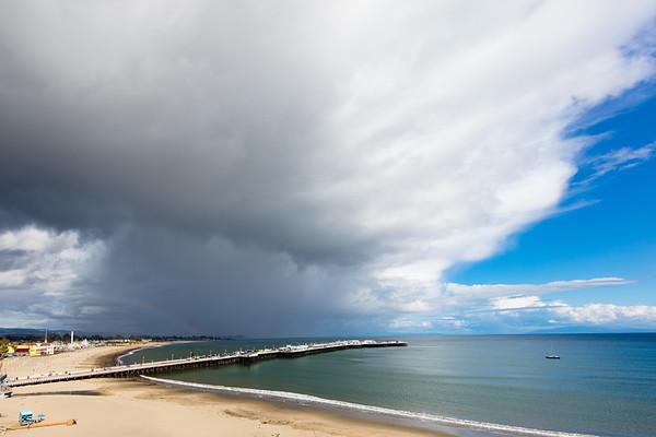 Santa Cruz with Clouds and Rainbow
