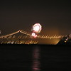 In all the nighttime photos of San Francisco, there is a plane visible. Fireworks going off on the otherside of the Bay Bridge.