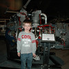Chandler in front of a Pratt & Whitney engine.