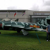 The boys in front of the MiG.