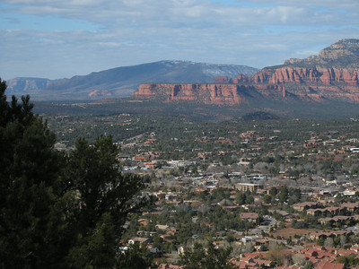 Red rocks and, at higher altitudes, some residual snow. View to northwest from near Sedona Airport.