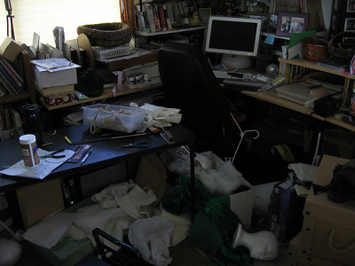 What we returned to; this is a portion of my ex-wife's workroom, and by no means the messiest part. This workroom, designed originally as a family and media room, occupied 25% of the house's square footage.