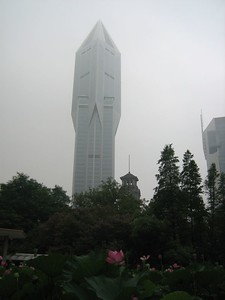 "Some lotus flowers reach high above the others, and so do some buildings. This tower building is called ""Tomorrow Square""   and includes a Marriott Hotel inside."