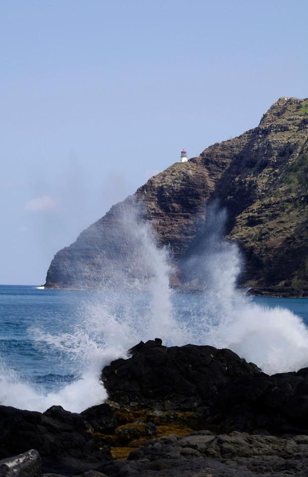 Lighthouse splash Oahu coast Hawaii