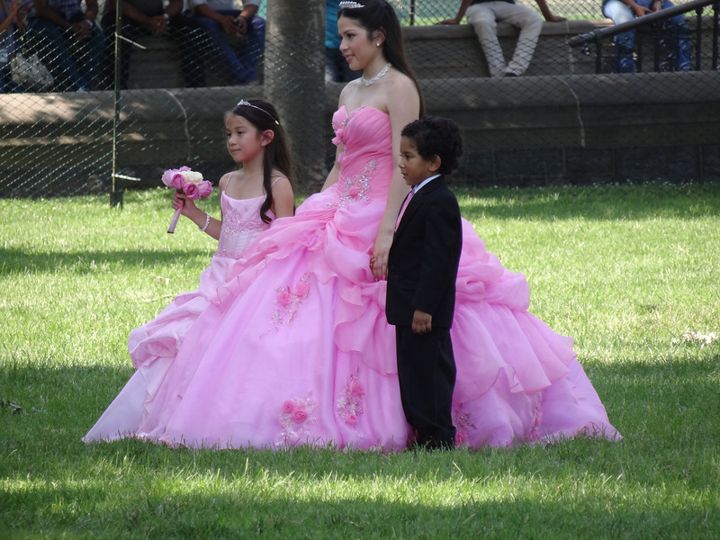 This young lady was taking photos for her quinceñera in front of the Capitol.