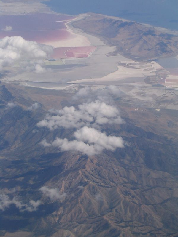 Picture from the airplane.  Why is the water at the top-left red?  I also saw two adjascent pools that were red and turqoise... so weird!