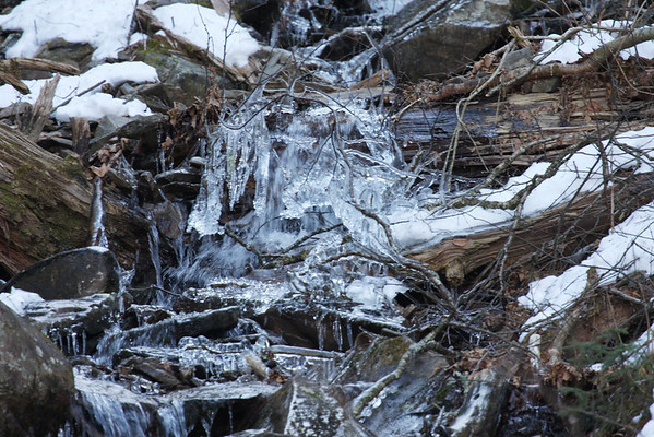 Frozen water on a mountain stream.