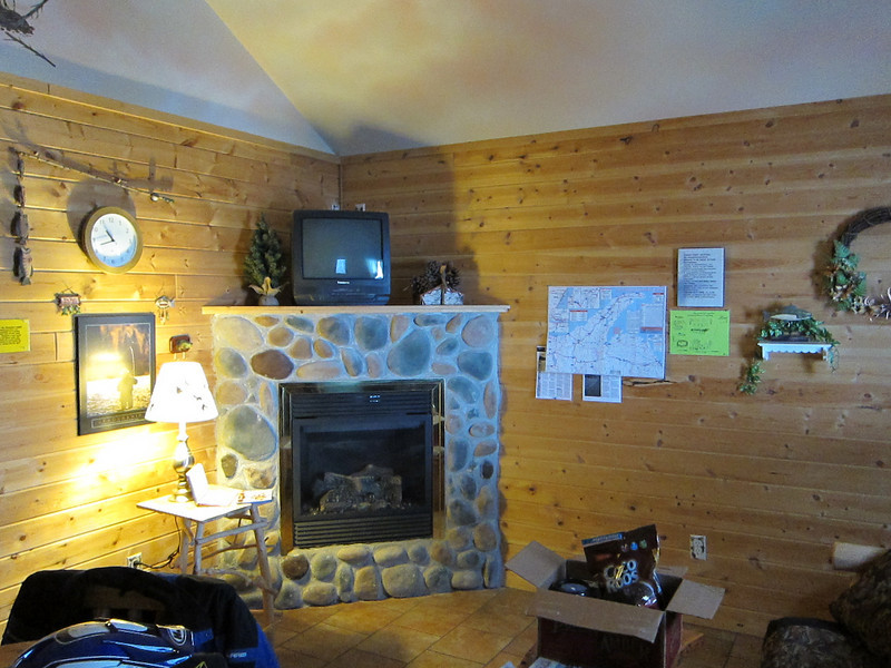 Inside of the cabin.  In the UP there are always rules posted somewhere (see to the right of the fireplace).  Rules, rules, rules.  Ack.