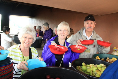Mary, Ginny and Bob helped prepare the apples, bananas, and plums that we bought for them at the market.
