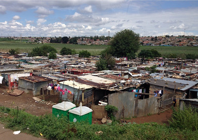 Here's a picture of a corner of the very large Soweto shantytown ghetto.  This is where the Apartheid riots started that ultimately led to the end of this awful racial injustice.  Unfortunately there is still a lot of poverty here in South Africa. Unemployment rate is extremely high.    We did not get off the bus here!
