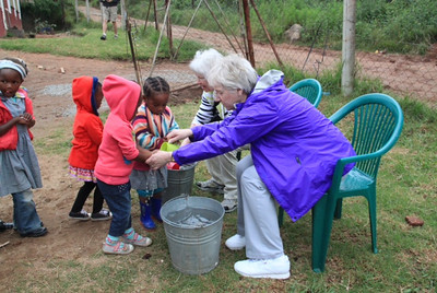We prepared some food for them for lunch. But before they had lunch, we had to help them wash their hands. Mary put on the soap and Ginny washed it off with water. Most of these children have no running water in their homes and the school tries to teach them basic hygiene.