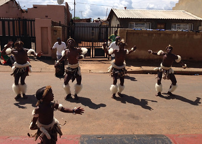 Here are some African warrior dancers that gave us an exhibition after our lunch today in Soweto.  The little boy in front was absolutely precious. He stole the show.