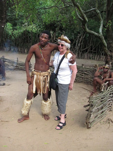 Mary posed with one of the Zulu warriors.  Note the headdress.