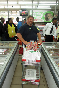 We were told that the staff at the school really wanted to make some chicken soup for the children, so we went to a super market and bought 10 bags (about 50 lbs!) of frozen chicken.  Here, our guide, J.P. pushes the cart of chicken though the store.