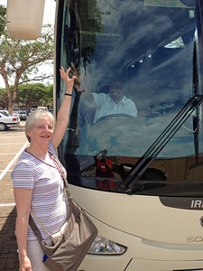 Ginny high-fiving our bus driver, Elon.