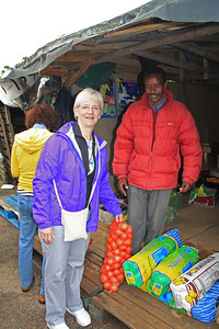 Two representatives from the local government social services advised us on what the school needed and everyone from the tour chipped in and bought produce.  Here, we bought an entire bag of onions.  We saw at least one other bag that someone else bought.