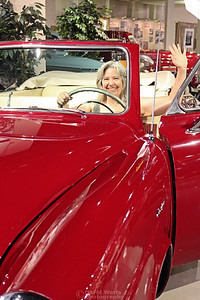 Diana Waves from a Studebaker