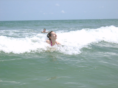 Kelly trying to catch a wave.