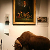 This is a painting of (I think) the first director of the museum and some of his prized items on display.  The some of the actua