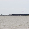 Fort sumpter, a tour boat is just leaving the docks.