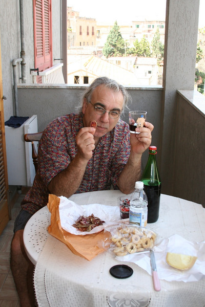 Lunch on our balcony: No label wine in a porky pig glass, dried sausage:soprasotta, cheese and hard bread.