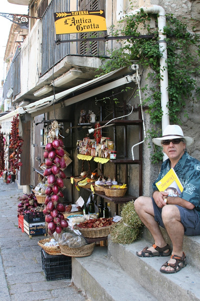 Joe sitting next to another favorite: Red Onions of Tropea at a typical goods shop