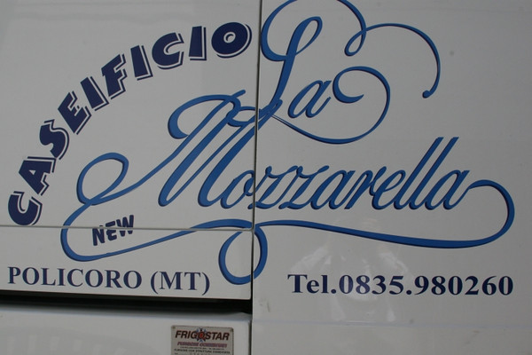 A dream come true. Door to Door fresh mozzarella truck on its daily rounds. (this was a small village)