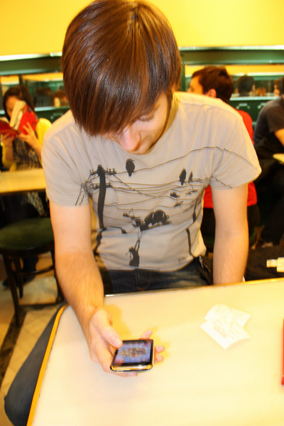 Ryan playing Settlers of Catan on the iPhone while we wait.