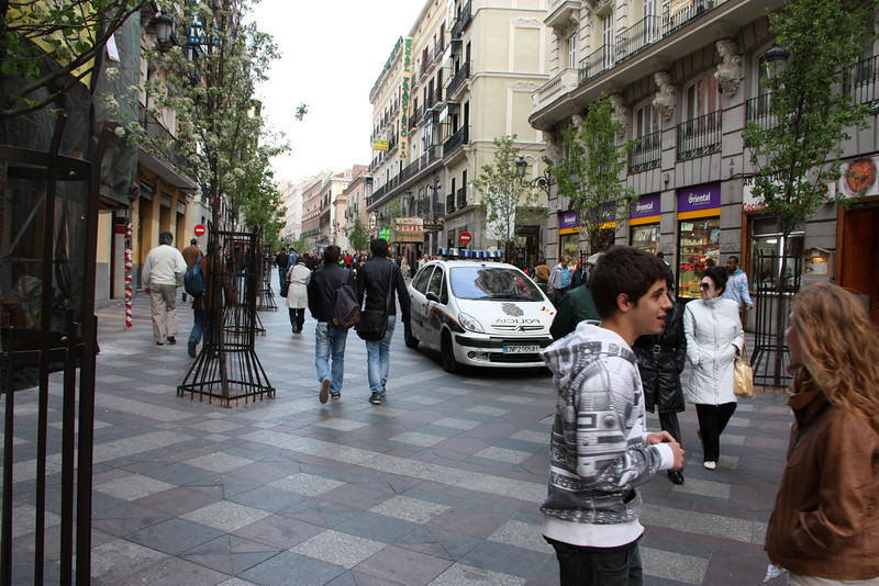 It looks like a pedestrian only street, but nope.  In Spain, they share the road.