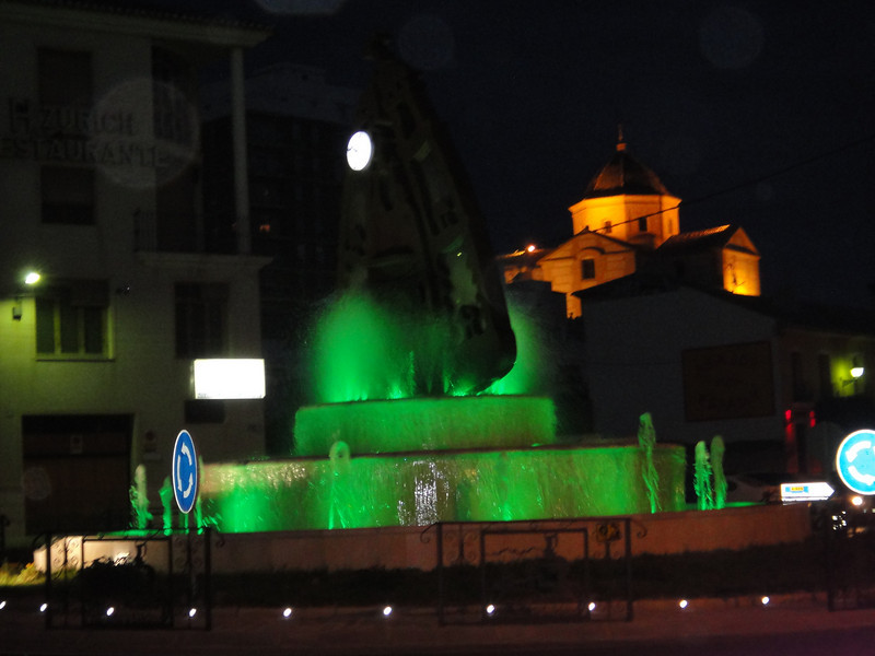 Town we stopped in for gas - cool fountain with church lit up in background