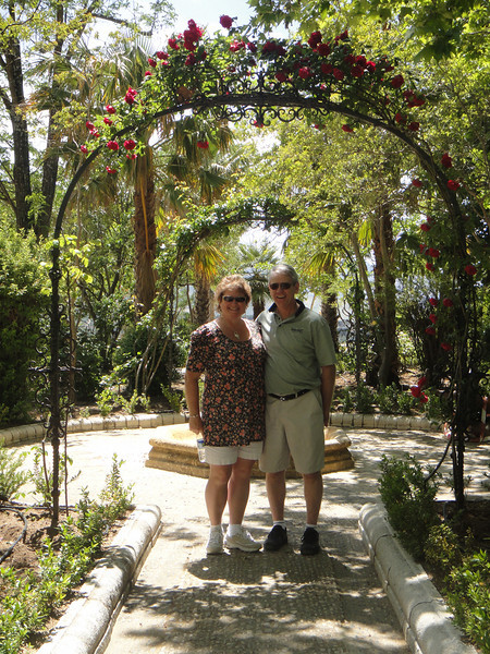 Russ and Mary under rose archway