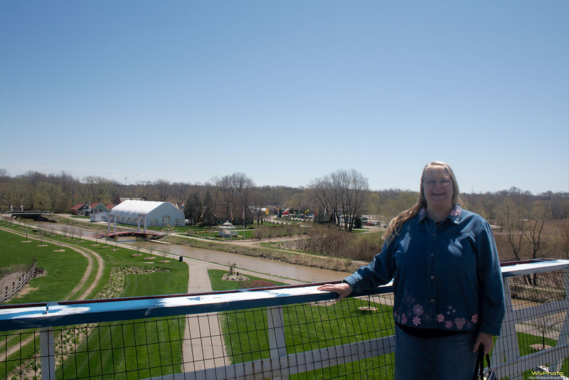 "Windmill Island Gardens<br /> This is a shot of Peggy taken from the windmill outside deck on the 4th floor. Sadly we arrived a little to early in the season to see the tulips in full bloom.<br /> <br />  <a href=""http://www.cityofholland.com/windmillislandgardens"">http://www.cityofholland.com/windmillislandgardens</a><br />  <a href=""http://bit.ly/melWRy"">http://bit.ly/melWRy</a>"