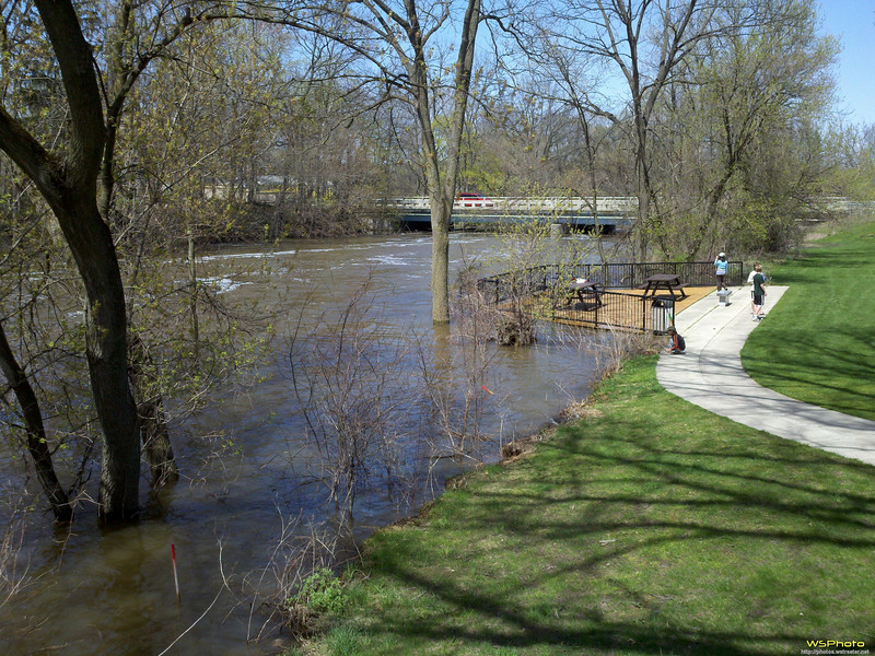 """Ada Covered Bridge<br /> Ada, MI<br /> <br /> The river was very high from the recent high volume of rain.<br /> <br />  <a href=""""http://www.wmta.org/ada-covered-bridge-186/"""">http://www.wmta.org/ada-covered-bridge-186/</a><br /> 7500 Thornapple River Drive, Ada, MI 49301<br /> <br /> Taken with my Droid X."""