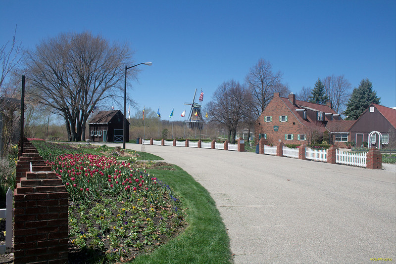 """Windmill Island Gardens<br /> The entrance area showing the Post House, Organ house and Windmill. Sadly we arrived a little to early in the season to see the tulips in full bloom.<br /> <br />  <a href=""""http://www.cityofholland.com/windmillislandgardens"""">http://www.cityofholland.com/windmillislandgardens</a><br />  <a href=""""http://bit.ly/melWRy"""">http://bit.ly/melWRy</a>"""