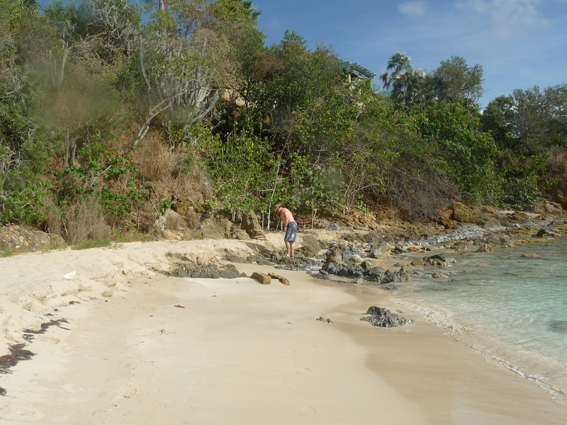 Hubby walking out on the penisula where we were just snorkeling. Sun was out one moment and under a cloud the next.