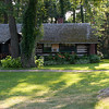 Our large cabin (Harry's).  It's big enough to hold 3 groups or, in our case, the kids in one room and a separate bedroom for each couple.  Common to all is a kitchen, a screened-in dining porch, and an outside deck.