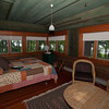 Harry's Cabin–Mark and Lela's bedroom in the back with all the windows