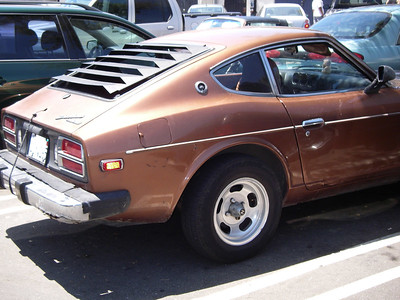 I saw this car in a parking lot - it's exactly the color and model of my very first car - a 1977 Nissan Datsun 280Z.  Good times!