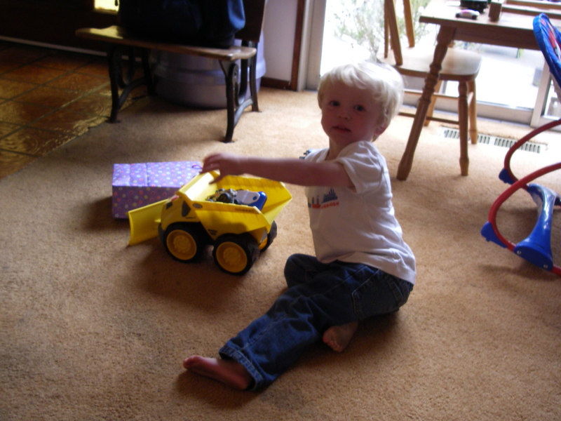 Henry playing with his big truck.