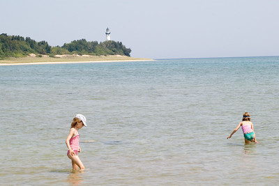 Enjoying the beach to ourselves on South Manitou Island (in Lake Michigan.)  The island's lighthouse in the distance.