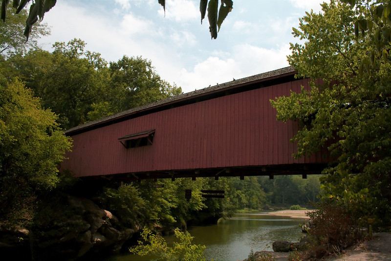 """Narrows Covered Bridge<br /> Parke County, Indiana<br /> Turkey Run State Park<br /> <br /> The Narrows Covered Bridge crosses Sugar Creek in Turkey Run State Park on its eastern boarder in Parke County. The first few photos were taken Saturday evening (7/7/2012) after what seemed to be a long hike (about 25 minutes in temps around 100) on trail 1 in Turkey Run State Park. Unfortunately the sun had set too low for the bridge to be lit well by the time I arrived. The other photos were taken after our trip to Bridgeton.<br /> <br />  <a href=""""http://www.countyhistory.com/coveredbridge/parke/narrows.htm"""">http://www.countyhistory.com/coveredbridge/parke/narrows.htm</a>"""