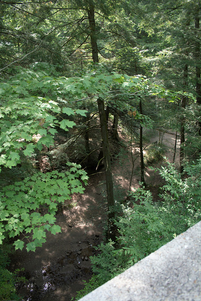 """View From the Old Highway Bridge<br /> Turkey Run State Park - Trail 11<br /> Near the Turkey Run State Park Inn<br /> <br /> A view from the old highway bridge down into part of trail 6. The bridge is now used for trail 11 and leads to the Old Log Church. This was on our way back from the Sunday morning service at the Old Log Church.<br /> <br /> Park Trails Map: <a href=""""http://www.in.gov/dnr/parklake/files/turkey_run_trail.pdf"""">http://www.in.gov/dnr/parklake/files/turkey_run_trail.pdf</a><br /> Official Park Site: <a href=""""http://www.in.gov/dnr/parklake/2964.htm"""">http://www.in.gov/dnr/parklake/2964.htm</a><br /> Google Map: <a href=""""http://goo.gl/maps/HAUB"""">http://goo.gl/maps/HAUB</a>"""