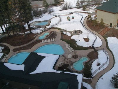 Note the heated cement surrounding the heated swim-out pool and dualling hottubs.