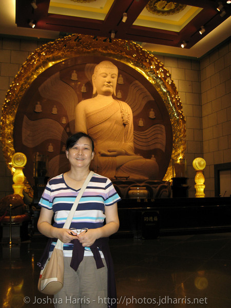 Connie's mom in front of another statue at the top of the stairs
