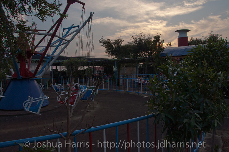 Abandoned theme park behind a temple