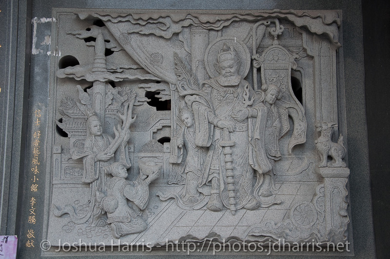 A storyboard tile on the exterior of the temple